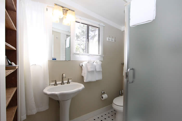 carmel lodging - bathroom with shower and sink