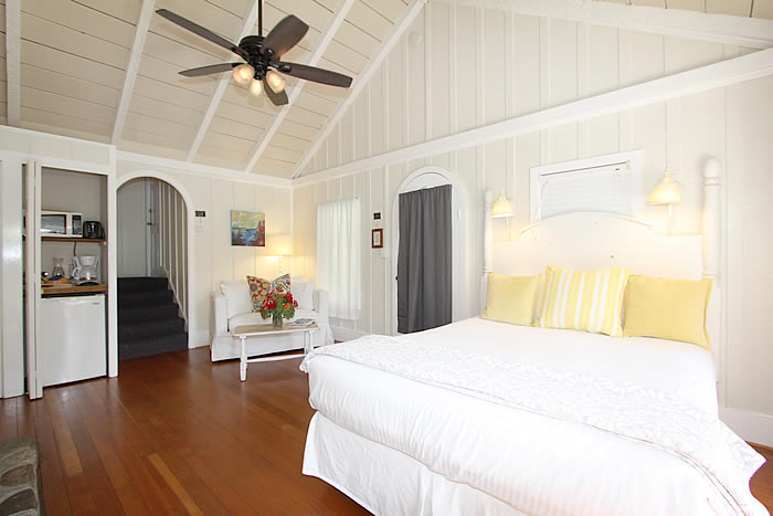 ocean avenue room with bed, fireplace, couch